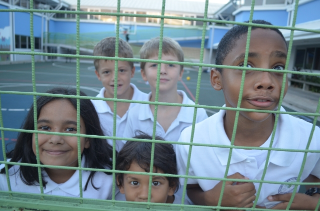 children behind fence